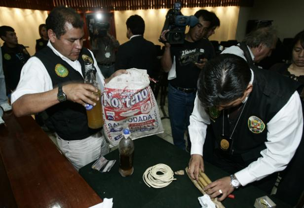 police-officer-in-lima-shows-off-bottles-of-human-fat