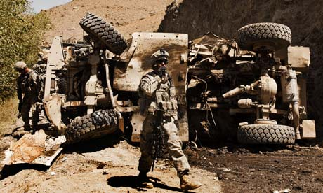 a-us-soldier-inspects-the-site-of-a-bomb-attack-in-afghanistan