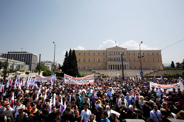 protestors-stand-in-front-of-the-greek-parliament-in-athens