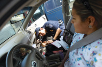 a-us-customs-and-border-protection-agent-inspects-a-vehicle