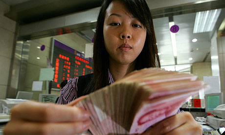 yuan-a-chinese-bank-teller-counts-notes-in-beijing