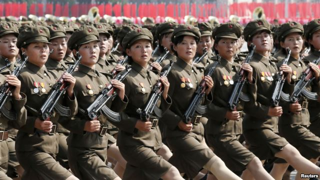 http://www.infiniteunknown.net/wp-content/uploads/2013/10/North-Koreas-Worker-Peasant-Red-Guard-members-attend-a-parade-marking-the-1948-establishment-of-North-Korea-in-Pyongyang-Sept.-9-2013.-.jpg