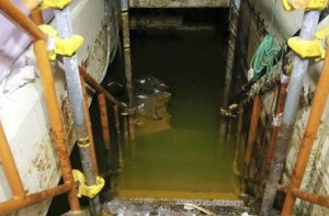 Green, contaminated water fills bottom of Unit 4