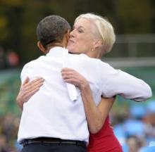 President Barack Obama hugs Planned Parenthood Federation of America President Cecile Richards