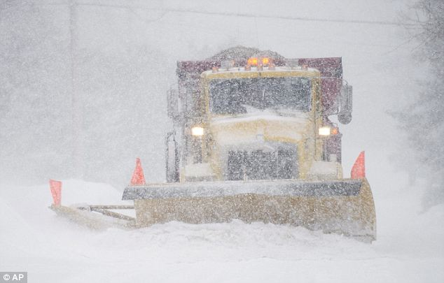 A snowplow is forced back to work in Montreal