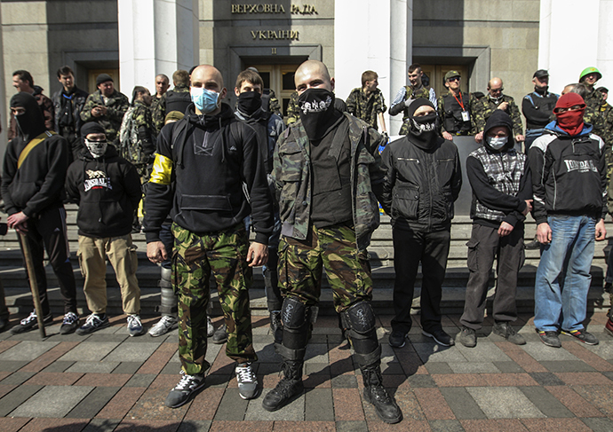 Members of the Ukrainian far-right radical group Right Sector stand outside the parliament in Kiev