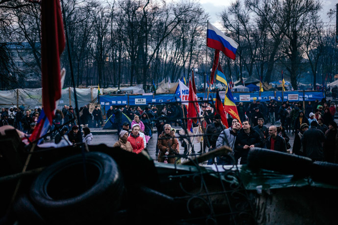 Pro-Russian activists gather outside the secret service building in the eastern Ukrainian city of Lugansk on April 14, 2014