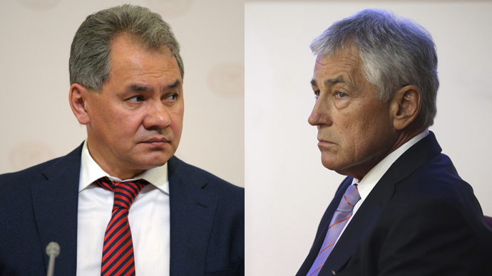 Russia's Defence Minister Sergey Shoigu (L) and U.S. Secretary of Defense Chuck Hagel (R)