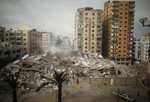 General view of the rubble of a residential tower, which witnesses said was destroyed in an Israeli air strike, is seen in Gaza City