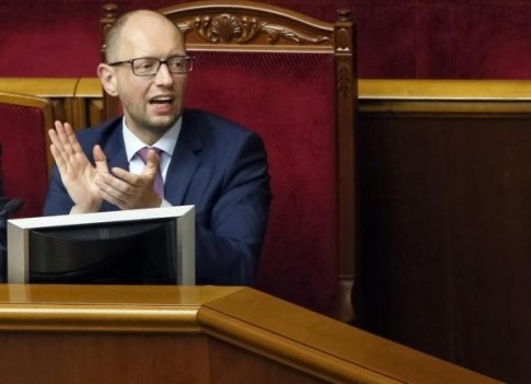Ukraine's Prime Minister Yatseniuk reacts during a session of the parliament in Kiev