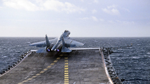 A Sukhoi Su-27K fighter takes off from the heavy aircraft carrying cruiser Admiral Kuznetsov of the Russian Northern Fleet.
