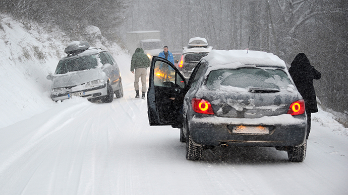 A car is stuck in the snow on December 27, 2014 on the road to Les Saisies ski resort in Savoie, central-eastern France.