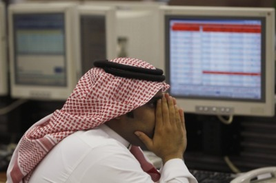 File picture shows a Saudi trader monitoring stocks at the Saudi Investment Bank in Riyadh