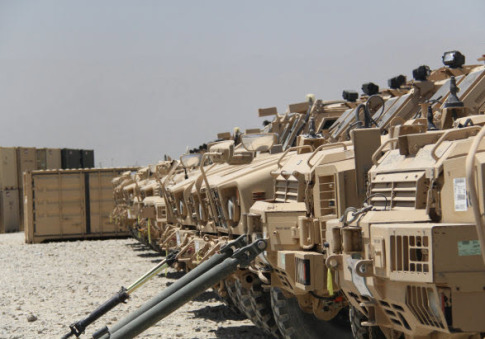 U.S. military has been slowly stockpiling massive amounts of its gear coming out of Afghanistan at a depot in Kuwait