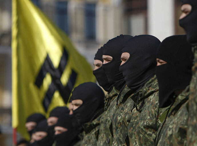 "New volunteers for the Ukrainian interior ministry's ""Azov"" battalion take their oath of allegiance to their country during a ceremony in Kiev"