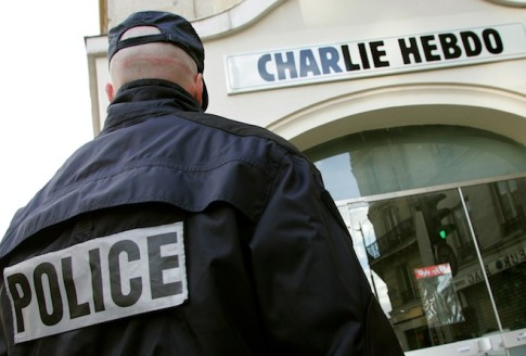 "File photo of a policeman standing guard outside the French satirical weekly ""Charlie Hebdo"" in Paris"