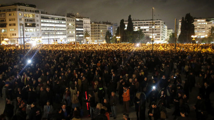 People gather for a pro-government rally outside the Greek parliament in Athens February 5, 2015