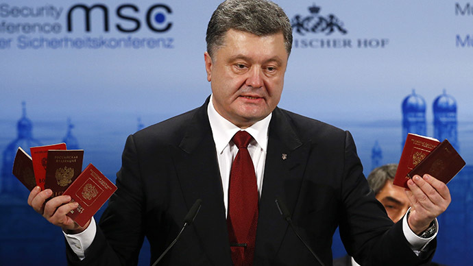 Ukraine President Petro Poroshenko holds Russian passports to prove the presence of Russian troops in Ukraine