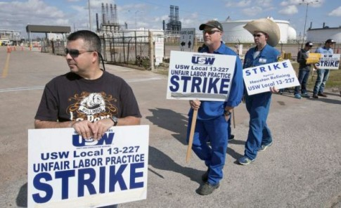 Workers from the USW union walk a picket line outside the Lyondell-Basell refinery in Houston, Texas.