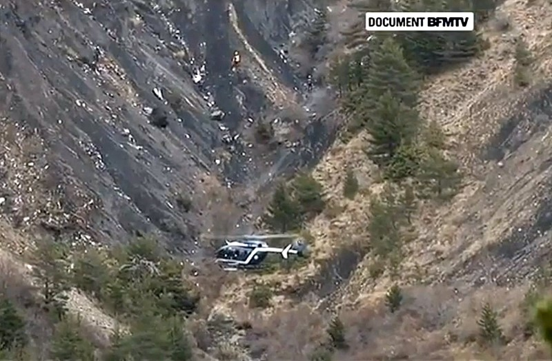 Rescue helicopter from the French Gendarmerie hovers in front of the crash site of an Airbus A320