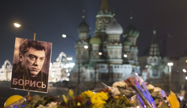 People pay their respects at the place where Boris Nemtsov, a Russian opposition leader, was gunned down, Moscow, March 2, 2015