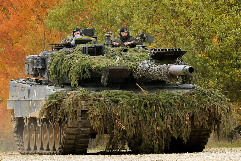 A German Army Leopard II tank, assigned to 104th Panzer Battalion, moves through the Joint Multinational Readiness Center during an exercise in Hohenfels, Germany, on Oct. 25, 2012
