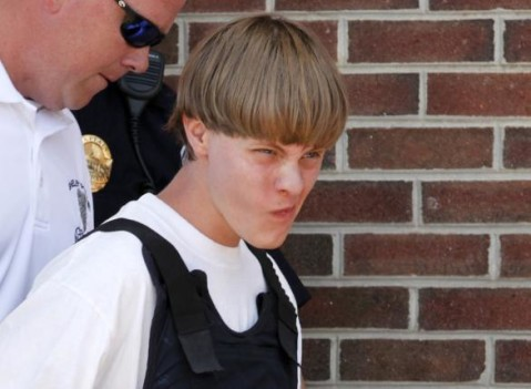 Police lead suspected shooter Dylann Roof, 21, into the courthouse in Shelby, North Carolina, June 18, 2015. REUTERS/Jason Miczek