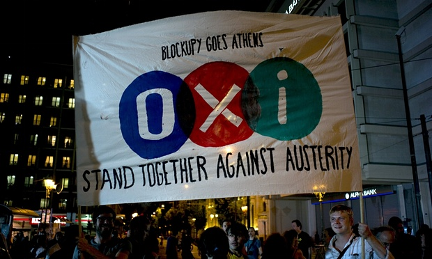 No vote supporters hold a banner during celebrations in Athens