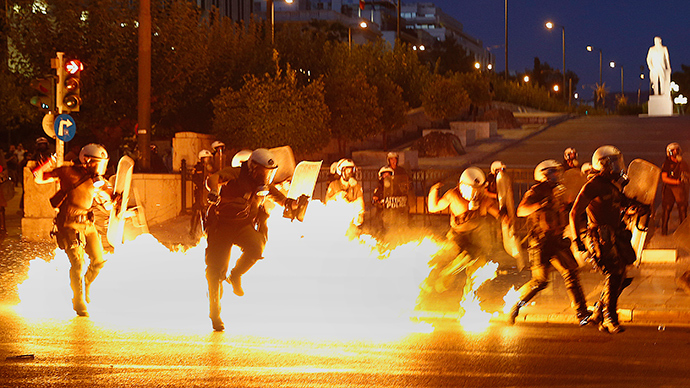 Riot policemen try to avoid an exploding petrol bomb during clashes in Athens, Greece July 15, 2015 (Reuters)