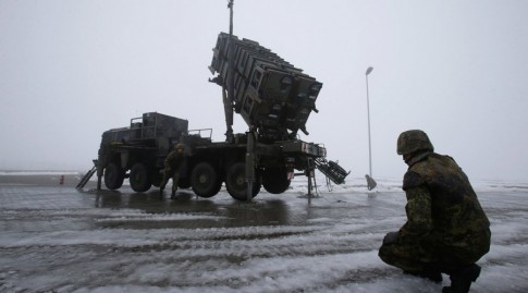Soldiers of the German armed forces Bundeswehr stand next to a PAC-2 launcher