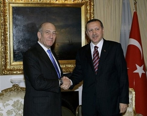 Israeli Prime Minister Ehud Olmert, left, and his Turkish counterpart Tayyip Erdogan shake hands as they pose for cameras before a meeting in Ankara, Turkey, Monday, Dec. 22, 2008.(AP Photo/Burhan Ozbilici, Pool)
