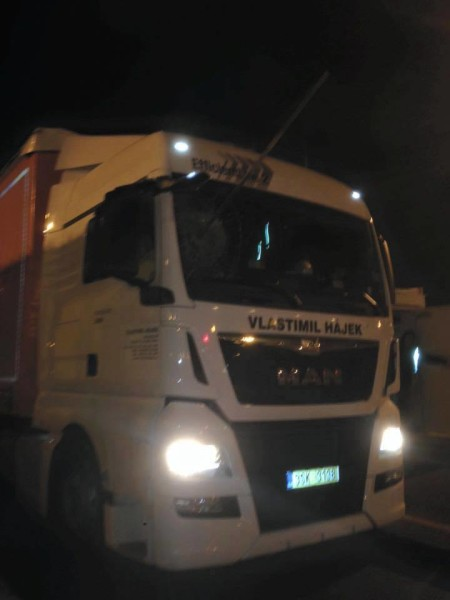 A Czech truck driver passing through Calais has narrowly avoided being killed by migrants when they hurled a long wooden stake through the window of his cab before mobbing his vehicle-2