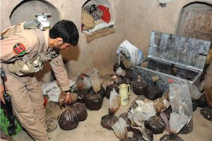 ANA soldier shows opium captured in an alleged Taliban safe house in Helmand.