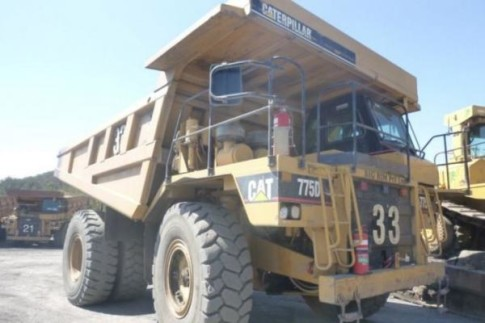 Caterpillar 775D rear dump truck