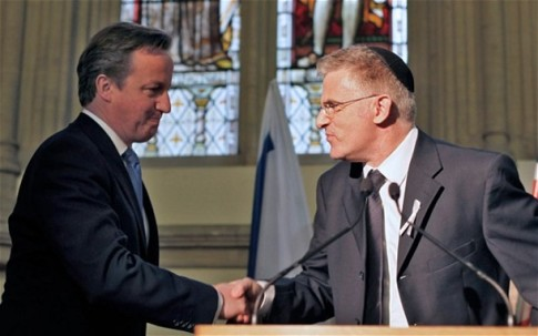 Cameron shares a Free-Masonic handshake with the Israeli Ambassador to Britain, Daniel Taub