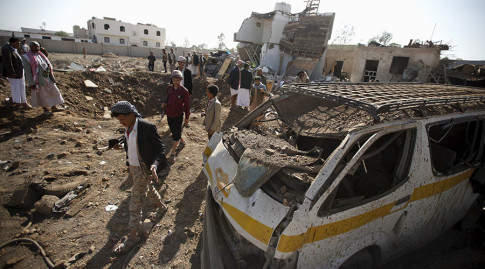 People gather at the site of a Saudi-led air strike in Yemens capital Sanaa January 6, 2016