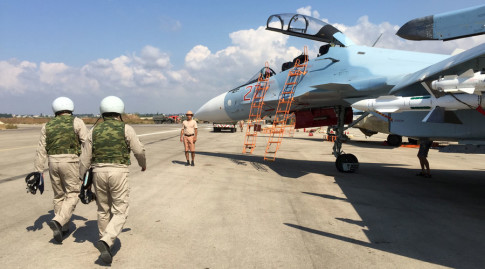 The crew of a Russian Su-30 fighter prepare to take off at Hmeimim aerodrome in Syria