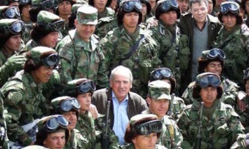 British Foreign Office minister Kim Howells posing with the Colombian High Mountain Battalion death squad
