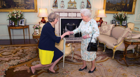 Queen Elizabeth welcomes Theresa May at the start of an audience in Buckingham Palace, where she invited her to become Prime Minister