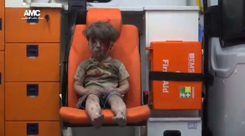 Aleppo Boy - Ash-covered child brings home horror of Syrian war to the world