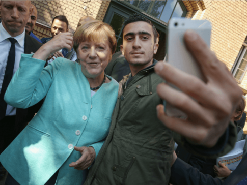 German-Chancellor-Angela-Merkel-poses-for-a-selfie-with-a-migrant-from-Syria-after-she-visited-the-AWO-Refugium-Askanierring-shelter-for-migrants
