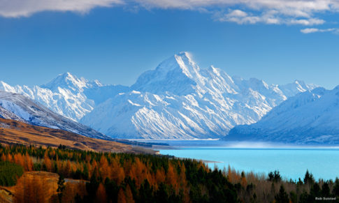 38773AM00: Aoraki / Mount Cook (3754m) and Lake Pukaki in winter. Mt La Perouse (3078m) left, Tasman Valley and Burnett Mountains Range right. Panorama with late autumn colours, Aoraki / Mount Cook National Park, MacKenzie District, New Zealand. Photocredit to be given as Rob Suisted / www.naturespic.co.nz.