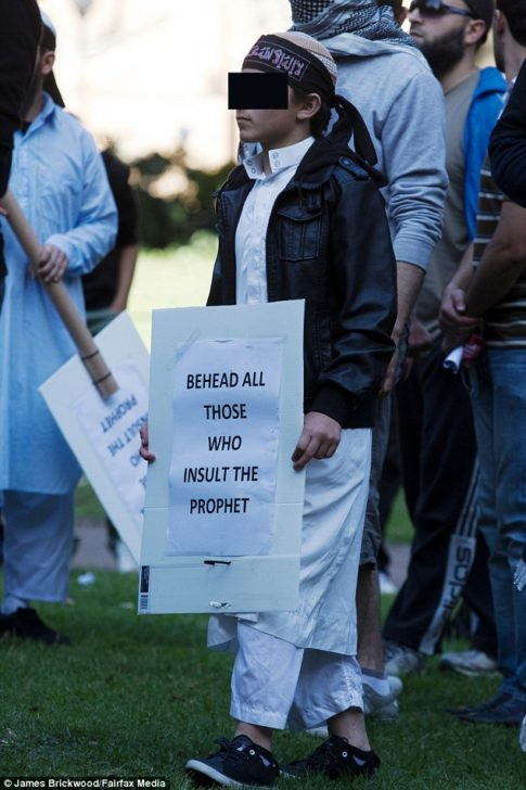 muslim-teen-was-pictured-with-banner-in-sydney-pleading-for-anyone-who-insults-allah-to-be-beheaded-four-years-ago
