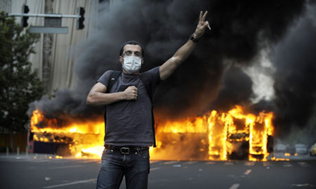 iran-unrest-smoke-billows-from-a-burning-bus