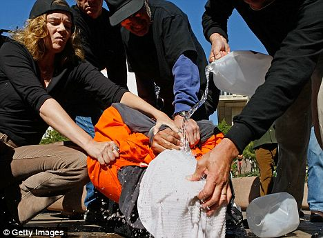 human-rights-activists-demonstrate-waterboarding