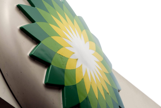 the-bp-plc-company-logo-is-displayed-on-a-sign-at-a-bp-gas-station-in-romford-uk