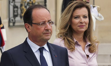 File photo of French President Hollande and first lady Valerie Trierweiler at the Elysee Palace
