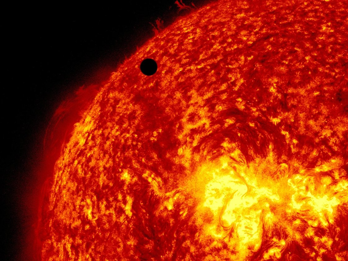 A view of Venus, black dot at top center, passing in front of the sun during a transit in 2012. A quarter of Americans questioned failed to answer correctly the most basic questions on astronomy