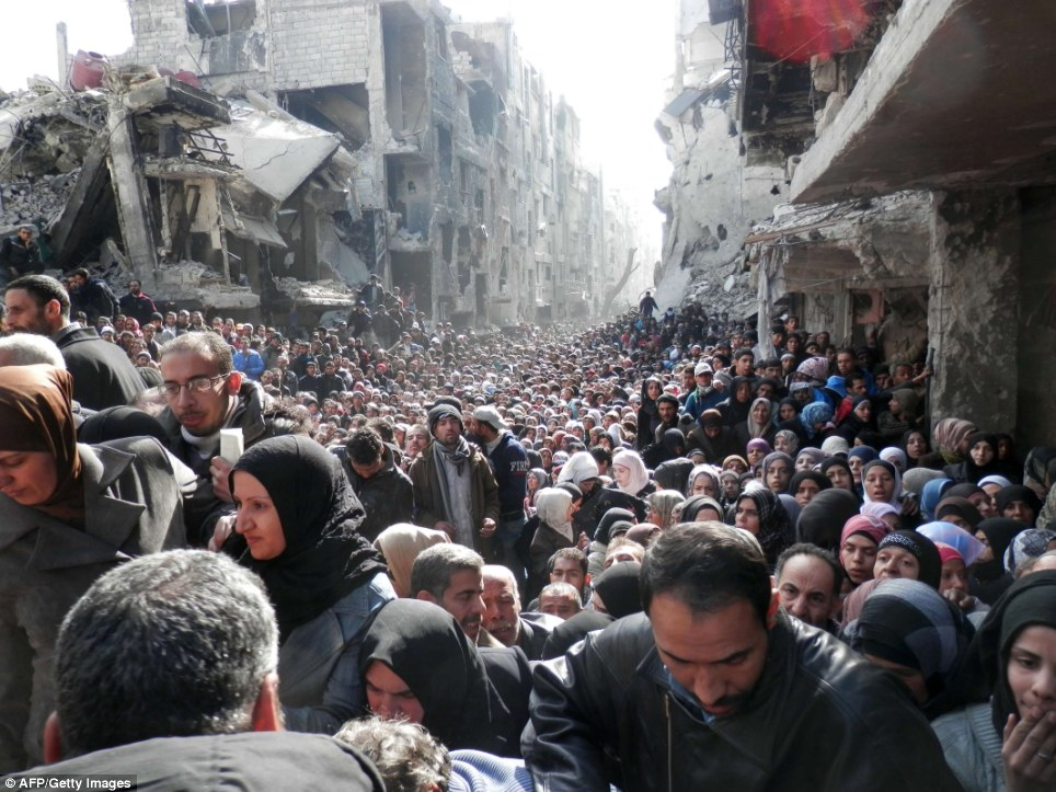 Syrias Starving Hordes -  A Biblical Picture Of Suffering, Crowd Gathers For UN Food Handouts