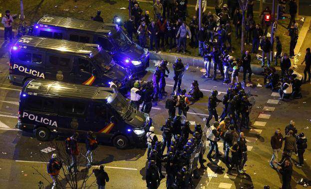 """Riot police confront protesters after disturbances broke out at the end of a demonstration which organisers have labelled the """"Marches of Dignity"""" in Madrid"""